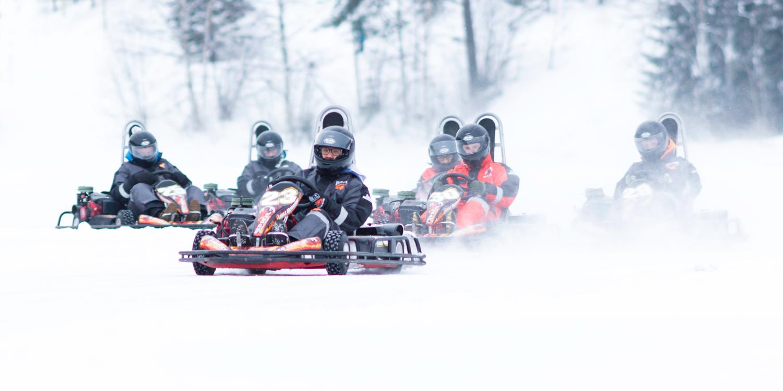 Speed through the snow on a snowmobile safari
