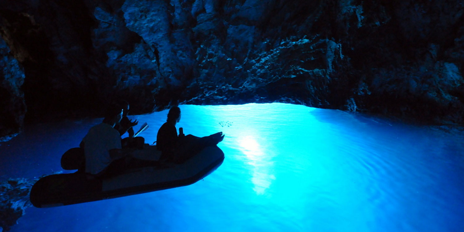 Explore the glowing Blue Cave